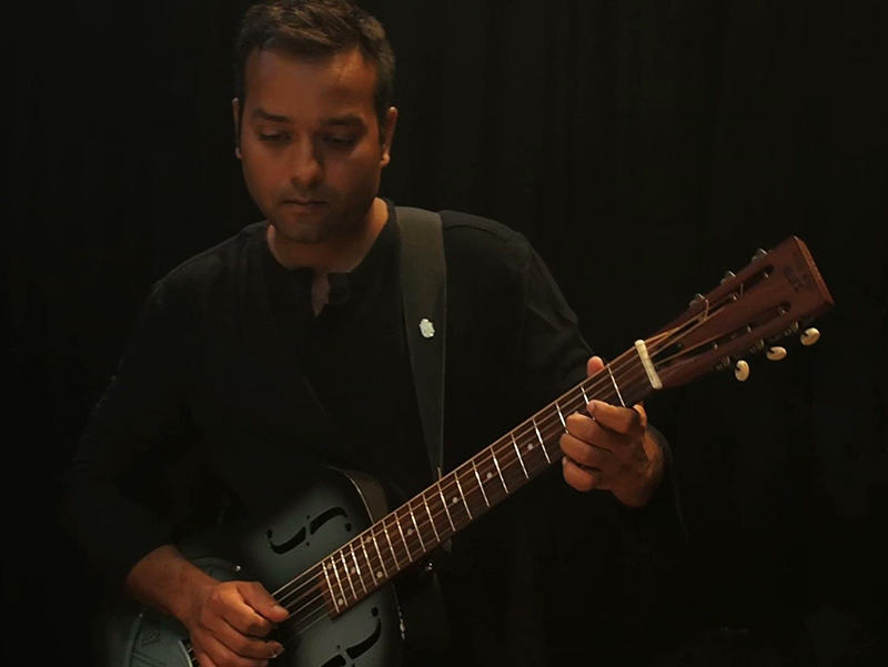 away srivastav with his resonator guitar